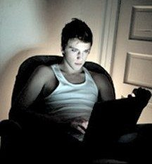 Man using a laptop at night with a high percentage of blue light emitted from the screen (note the bluish cast on his face). All LED screens by their very design nature emit a high percentage of blue light.