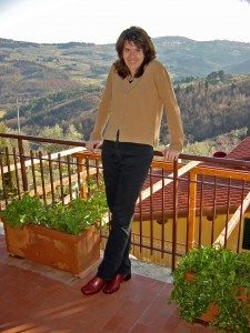 Leanne Venier on her Florence home terrace with view of Tuscan hills