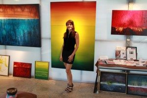 Leanne Venier with her international award-winning paintings in her Leanne Venier Gallery, Austin, Texas